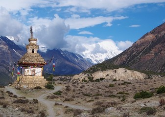Buddhist chorten in wilderness mountain landscape, Himalayas