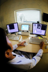 veterinarian doctor working in CT scanner computer control