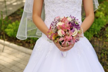 bride holding a wedding bouquet in hand