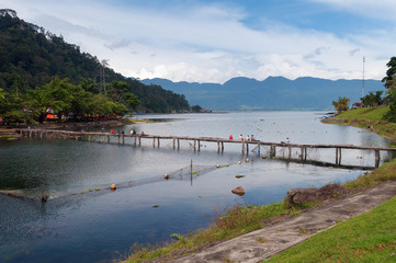 Bridge with fishermen on Lake Maninjau