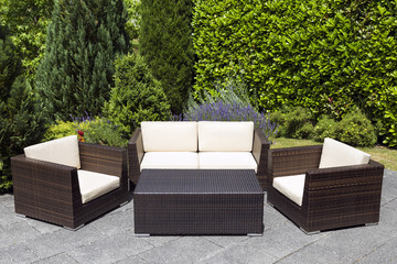 Outdoor garden furniture group in green garden