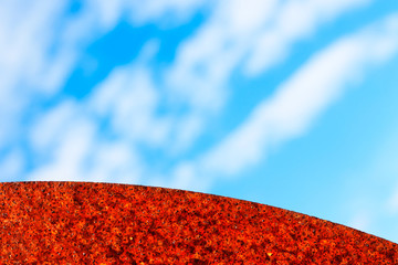 Abstract Background Photo with Blue Sky and Rusted Curve