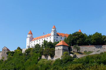 Bratislava Castle against the blue sky in the sunny summer day