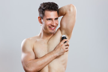 Man using antiperspirant