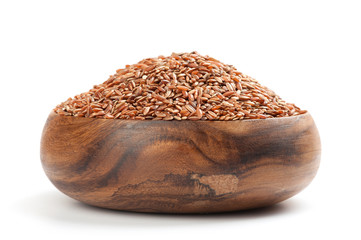 long-grain red rice on white background
