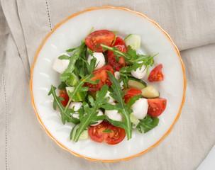 salad from arugula tomato and mozzarella