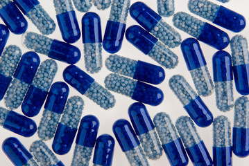 Blue pills background isolated on white