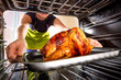 Cooking chicken in the oven at home. - 67120519