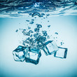 canvas print picture - Ice cubes falling under water