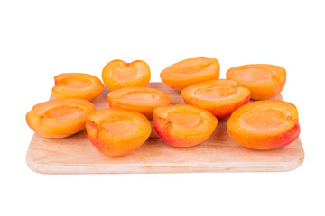 apricots cut in halfs on the kitchen board