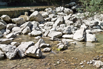Low shot of pebbles and stones along a river
