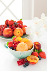 Peach sorbet and fresh berries, selective focus