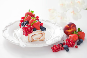Cake roll with fresh berries, selective focus