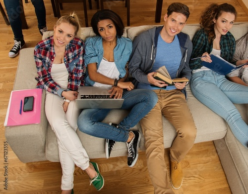 Group of multi ethnic students at home
