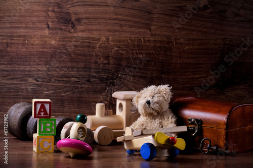 Leinwanddruck Bild collection of old wood children toys with teddy bear