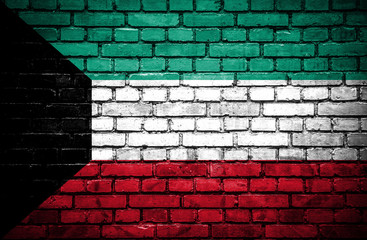 Brick wall with painted flag of Kuwait
