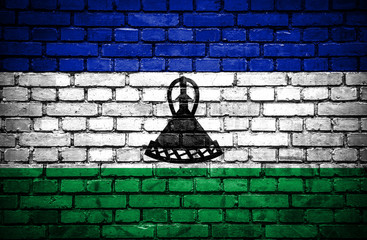 Brick wall with painted flag of Lesotho