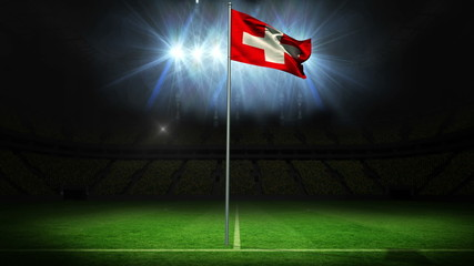 Swiss national flag waving on flagpole