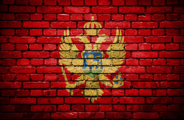 Brick wall with painted flag of Montenegro