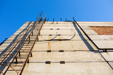 Old vertical industrial metal rusted ladder. Staircase