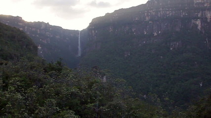 Flight over jungles, with  waterfall far shoot