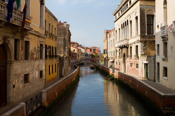 Canal, bridge and ancient buildings in Venice.