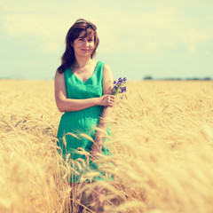 Woman portrait on wheat field