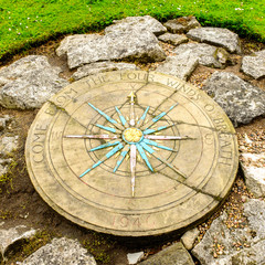 A compass rose next to York's Medieval City Walls.