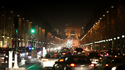 Night fires of cars on the Champs Elysee. Paris.