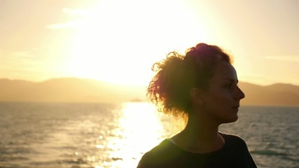 Thoughtful Woman Standing against Sunrise. Slow Motion.