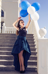 beautiful elegant girl with dark hair with baloons