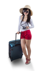 Attractive female tourist isolated