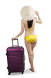 Attractive woman in bikini holding suitcase