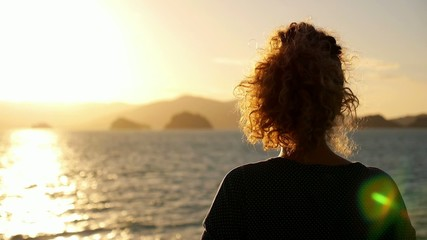 Dreamy Woman Enjoying Seascape during Sunrise. Slow Motion.