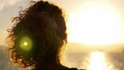 Woman Enjoying Sunrise. Beautiful Sunlit Seascape. Slow Motion.
