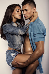 sexy beautiful couple in jeans clothes