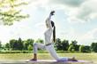 Leinwanddruck Bild - Pretty woman doing yoga exercises in the park.