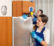 Man and woman cleaning in room
