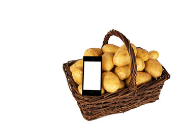Market-basket with raw potatoes and a self designed smartphone