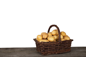 Wicker-basket with fresh harvested raw potatoes