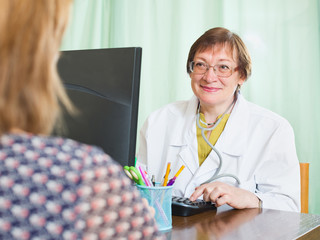 Doctor inserting information about patient