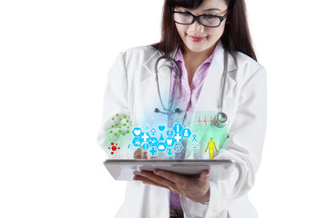 Doctor with medical apps on digital tablet 1
