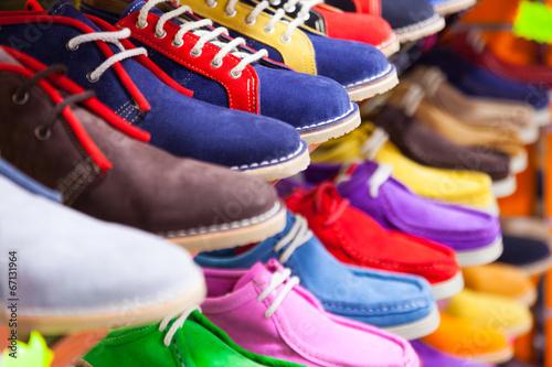 Leinwanddruck Bild lots of sport shoes