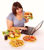 Woman eating junk food.