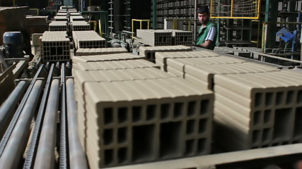 Worker in the production of hollow bricks