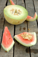 Watermelon and melon on gray wooden background