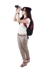Female student using binocular