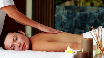Peaceful brunette enjoying a massage
