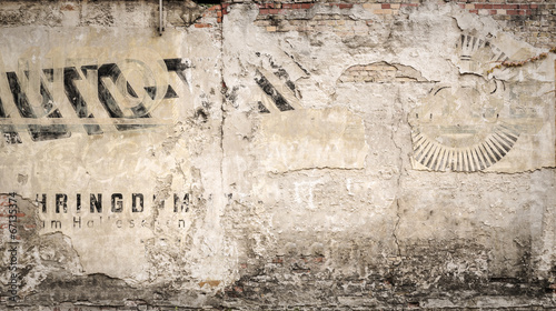 hundred years old advertising on a grungy wall, for backgrounds © Armin Staudt
