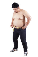 Obese person measuring his belly 3